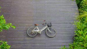 Vintage bicycle on wooden floor at Sri Nakhon Khuean Khan Park a